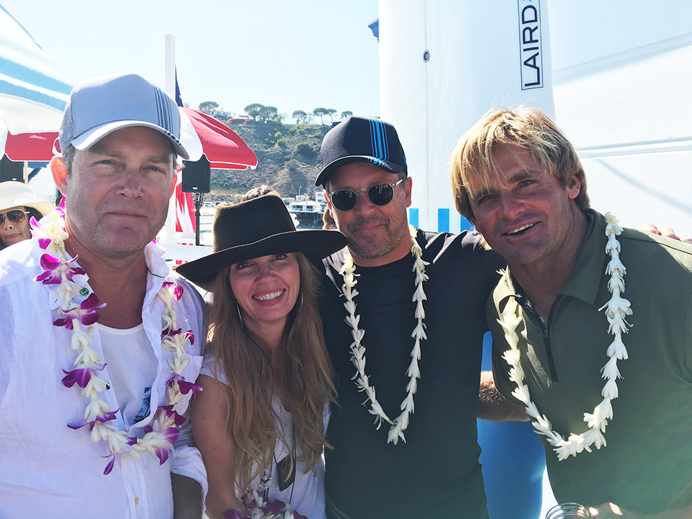 Laird Hamilton ( far right ) , William Cawley of Laird Apparel and guests.